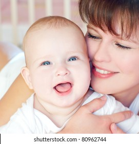 happy young mother with baby
