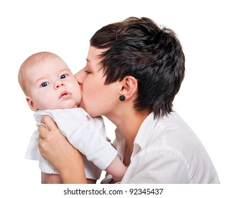 happy young mother with a baby on a white background.kiss