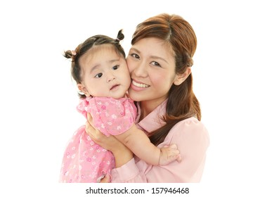 Happy young mother with cute baby