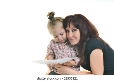 happy young mother and cute little girl reading book isolated on white background