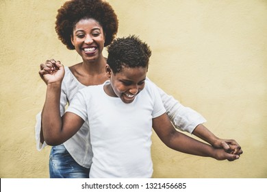 Happy young mother having fun with her child - Mom playing and dancing with his son - Family lifestyle, motherhood, love and tender moments concept - Focus on boy face