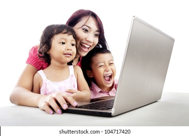 Happy young mother with her children using ultrabook laptop computer