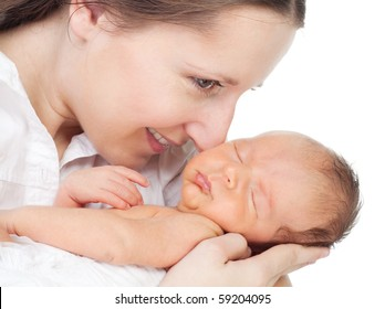 Happy young mother  with her newborn son on white