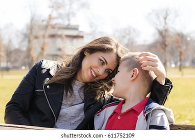 happy young mother and her nine year old son in the park.