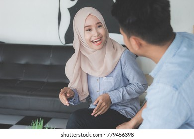 happy young muslim friend laughing together and having a good talk in a coffeshop