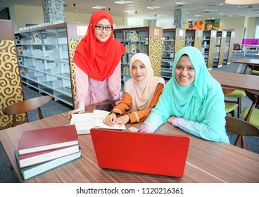 Happy young muslimah students studying in groups