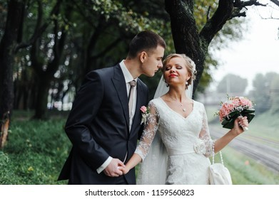 Happy young newlywed couple out in the nature. The wedding day