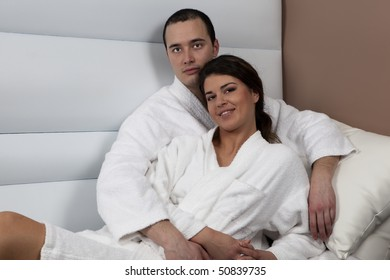 Happy young nice cople very close, in spa, relaxing and having great time together.