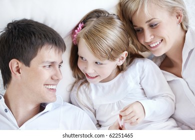 Happy young parents and baby closeup