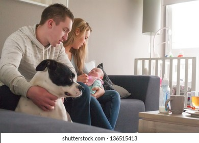 Happy young parents and their little baby