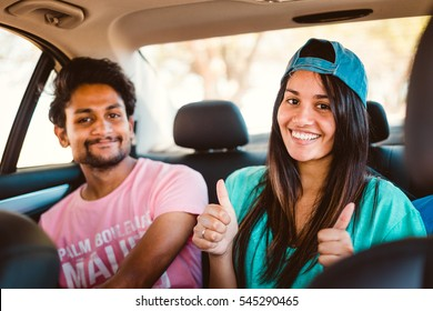 Happy young people in a car on a road trip