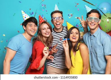 Happy young people celebrating birthday together on color background