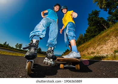 Happy young people rollerblading, skateboarding