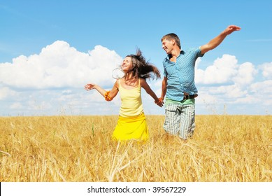 Happy young people running on rural background