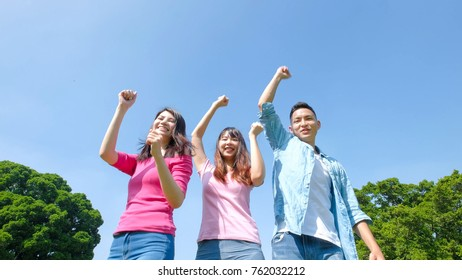 happy young people smile happily and jump
