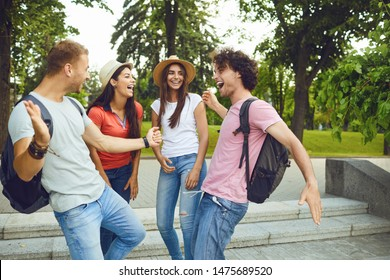 Happy young people smiling dance at a gathering in a city park
