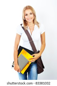 Happy young pretty student girl holding books, standing looking and smiling portrait, study, education, knowledge, learn concept, isolated
