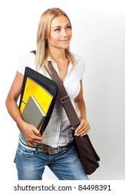 Happy young pretty student girl holding books, back to school concept