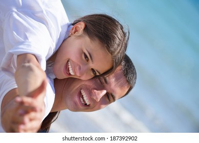 happy young romantic couple in love have fun running and relaxing on beautiful beach