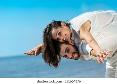 happy young romantic couple in love have fun on beautiful beach