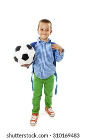 Happy young school boy holding a football. Isolated on white background