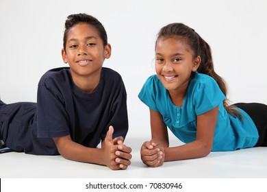 Happy young school friends boy and girl relaxing