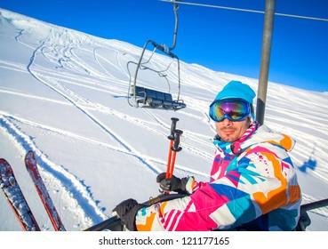 Happy young skier men on a ski-lift, Tirol, Austria