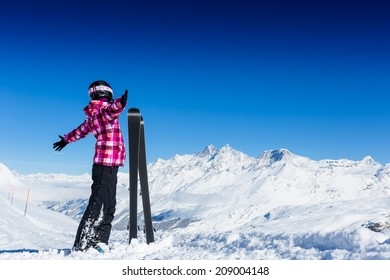 Happy young skier in mountains. Alps.