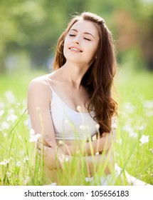 happy young slim brunette woman enjoying the sun outdoor on a summer day