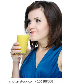 Happy young smiling girl in a blue dress. Holding a glass of juice. Isolated on white background