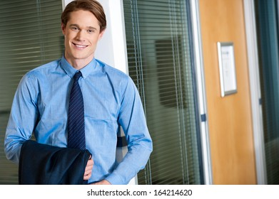 Happy young smiling relaxed businessman