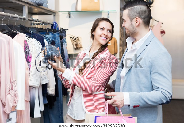 Happy young spouses while shopping at boutique