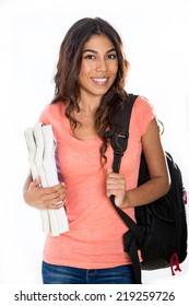 Happy young student with books and backpack