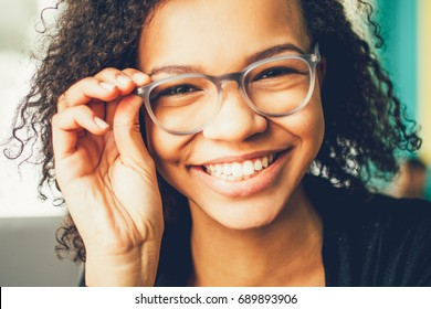 Happy young student or businesswoman in eyeglasses