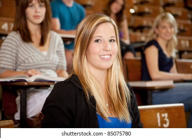 Happy young student at university class