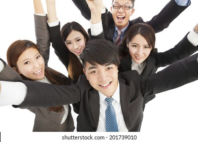 happy young success business team raise hands