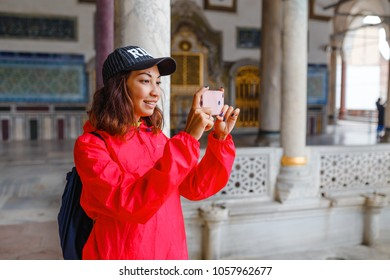happy young tourist woman visit ancient Istanbul Topkapi palace