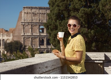 happy young tourist woman in yellow blouse in Rome, Italy with coffee and Italian mini crostata