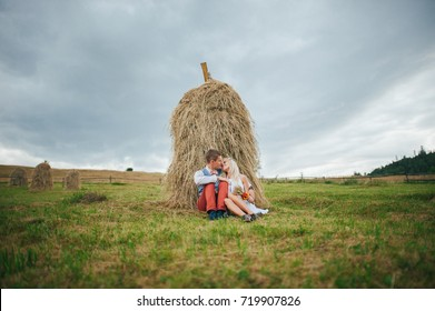 happy young wedding couple outdoors in cloudy day