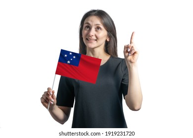 Happy young white woman holding flag of Samoa and points thumbs up isolated on a white background.