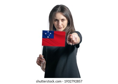 Happy young white woman holding flag of Samoa and points forward in front of him isolated on a white background.