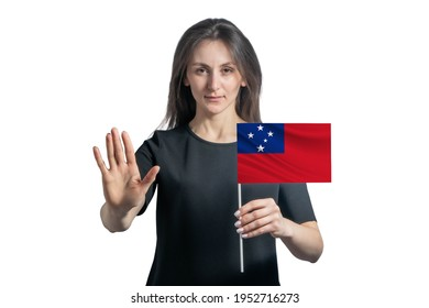 Happy young white woman holding flag of Samoa and with a serious face shows a hand stop sign isolated on a white background.