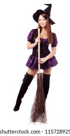 happy young  witch with  a broom, isolated on white studio background