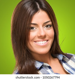 Happy young woman against a green background