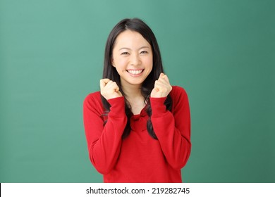 happy young woman against green background
