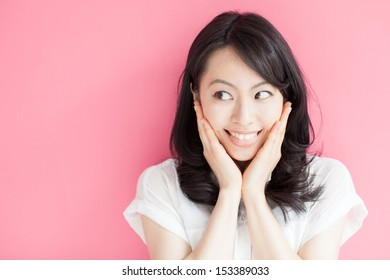 happy young woman against pink background