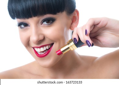 Happy Young Woman Applying Lipstick