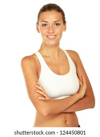 Happy young woman with beautiful slim body in sport clothes - isolated on white background