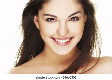 A happy young woman with big smile on white background