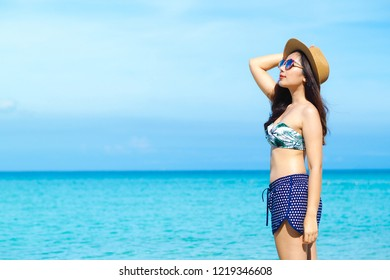 Happy young woman in bikini enjoy summer vacation on the beach